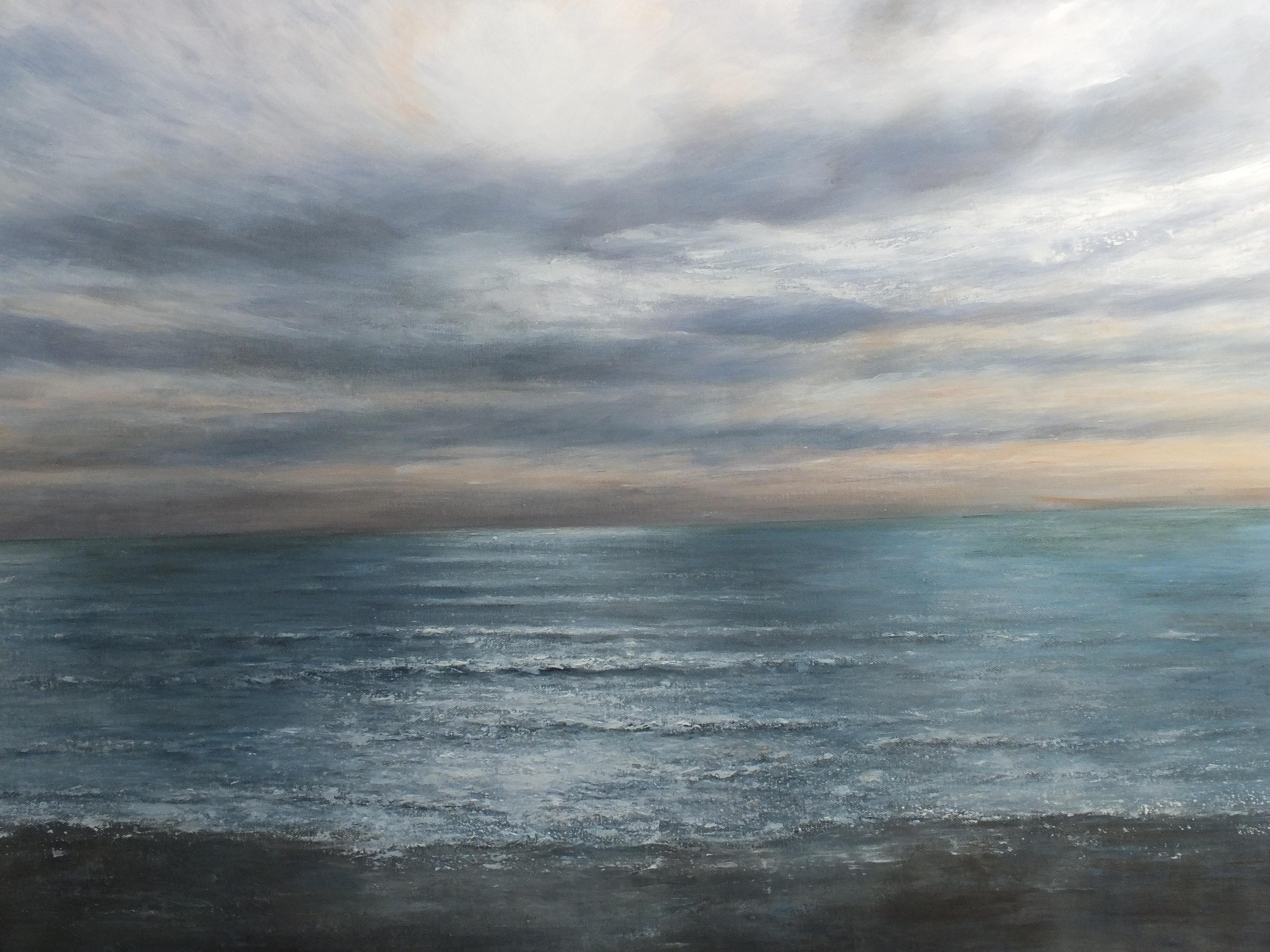 Sparkling white capped waves and big surf crashing ashore.